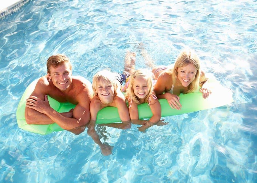 Family Outside Relaxing Swimming Pool in Salt Lake City
