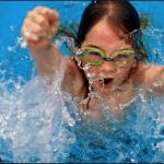 Kid Enjoying the Swimming Pool at Deep Blue Pools and Spas